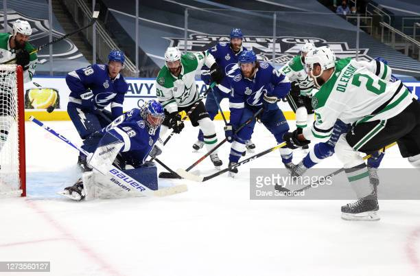 Goaltender Andrei Vasilevskiy of the Tampa Bay Lightning can't make the save on a shot for a goal by Jamie Oleksiak of the Dallas Stars in the second...