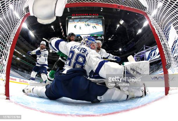 Goaltender Andrei Vasilevskiy of the Tampa Bay Lightning can't make the save on a deflected shot for a goal by Joe Pavelski of the Dallas Stars in...