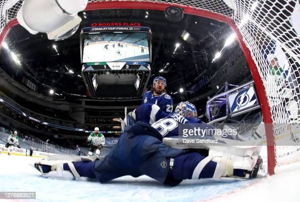 Goaltender Andrei Vasilevskiy of the Tampa Bay Lightning can't make the save on a shot for a goal by Joe Pavelski of the Dallas Stars as Ryan...