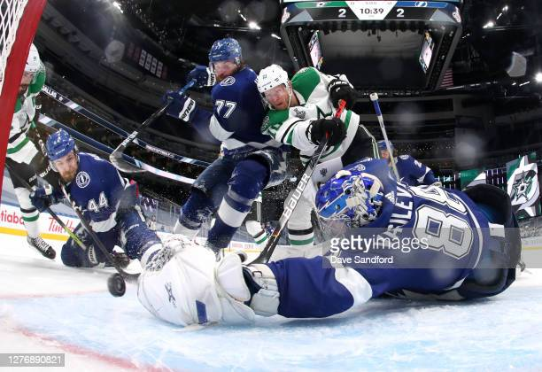 Goaltender Andrei Vasilevskiy of the Tampa Bay Lightning can't make the save on a shot for the gamewinning goal by Corey Perry of the Dallas Stars in...