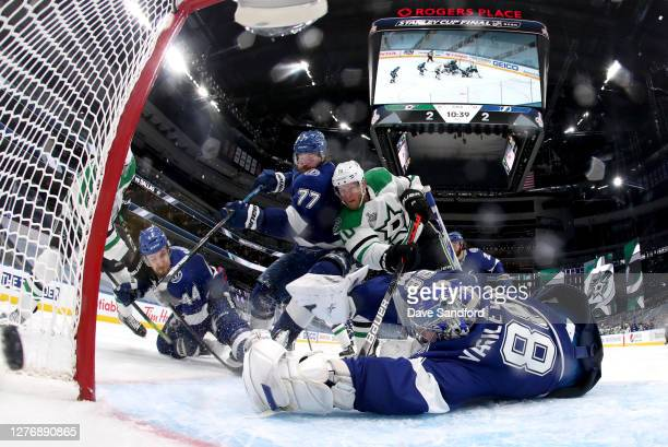 Goaltender Andrei Vasilevskiy of the Tampa Bay Lightning can't make the save on a shot for the game-winning goal by Corey Perry of the Dallas Stars...