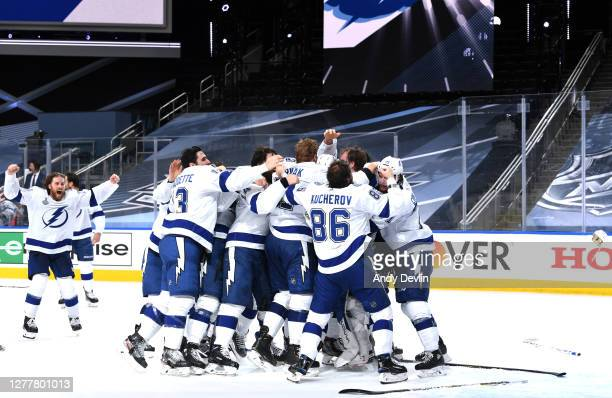 Goaltender Andrei Vasilevskiy of the Tampa Bay Lightning is mobbed by his teammates on the ice after they defeated the Dallas Stars 2-0 in Game Six...