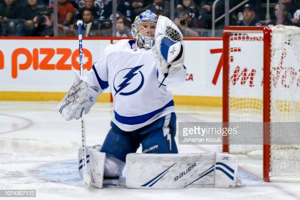 Goaltender Andrei Vasilevskiy of the Tampa Bay Lightning makes a glove save during third period action against the Winnipeg Jets at the Bell MTS...