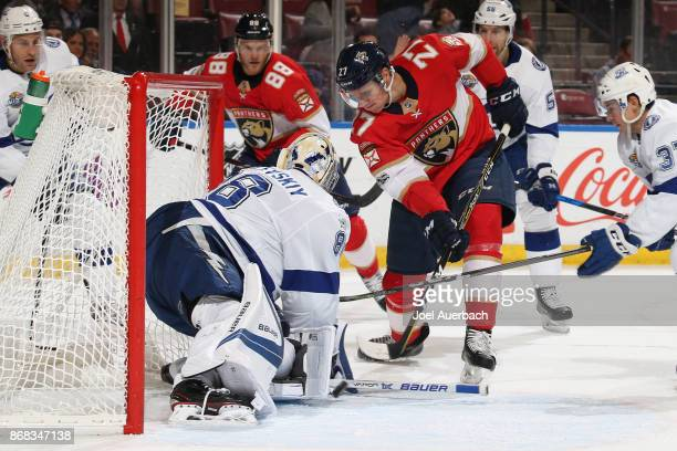 Goaltender Andrei Vasilevskiy of the Tampa Bay Lightning stops a shot by Nick Bjugstad of the Florida Panthers during first period action at the BBT...