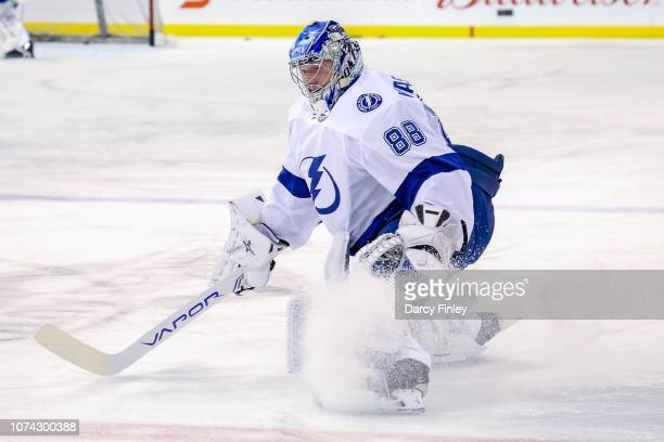Goaltender Andrei Vasilevskiy of the Tampa Bay Lightning stretches on the ice during the pregame warm up prior to NHL action against the Winnipeg...