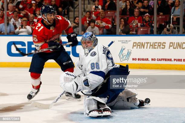 Goaltender Andrei Vasilevskly of the Tampa Bay Lightning defends the net against Vincent Trocheck of the Florida Panthers at the BBT Center on...