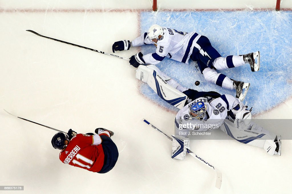 Goaltender Andrei Vasilevskly #88 of the Tampa Bay Lightning defends the net with the help of teammate Dan Girardi #5 against Jonathan Huberdeau #11 of the Florida Panthers at the BB&T Center on October 30, 2017 in Sunrise, Florida.