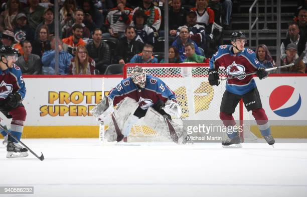 Goaltender Andrew Hammond and Samuel Girard of the Colorado Avalanche defend against the Philadelphia Flyers at the Pepsi Center on March 28 2018 in...
