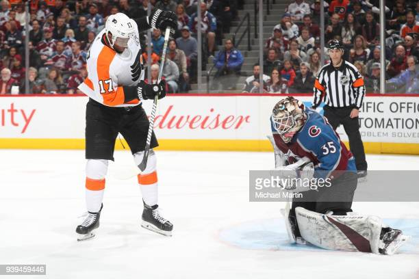 Goaltender Andrew Hammond of the Colorado Avalanche makes a save against Wayne Simmonds of the Philadelphia Flyers at the Pepsi Center on March 28...