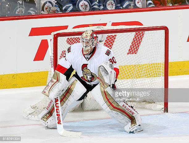 Goaltender Andrew Hammond of the Ottawa Senators guards the net during second period action against the Winnipeg Jets at the MTS Centre on March 30...