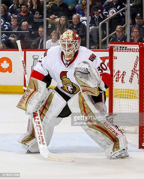Goaltender Andrew Hammond of the Ottawa Senators guards the net during third period action against the Winnipeg Jets at the MTS Centre on March 30...