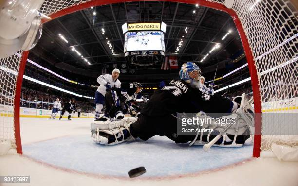 Goaltender Antero Niittymaki of the Tampa Bay Lightning looks back at the net after Nikolai Kulemin of the Toronto Maple Leafs scored during the...
