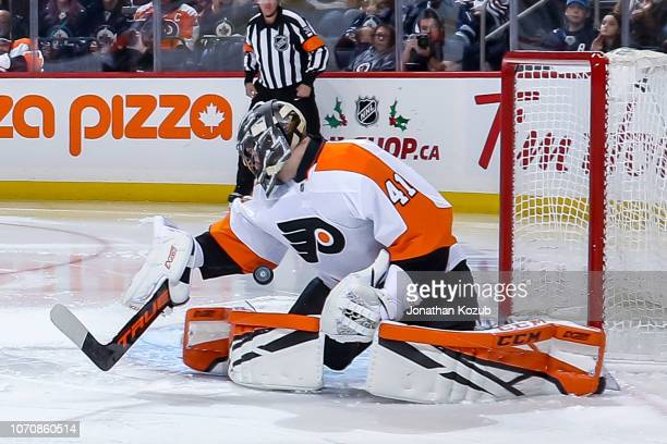 Goaltender Anthony Stolarz of the Philadelphia Flyers makes a save during third period action against the Winnipeg Jets at the Bell MTS Place on...