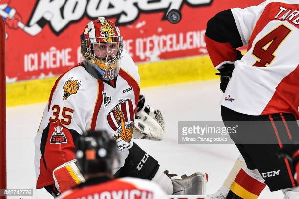 Goaltender Antoine Samuel of the BaieComeau Drakkar watches the puck against the BlainvilleBoisbriand Armada during the QMJHL game at Centre...