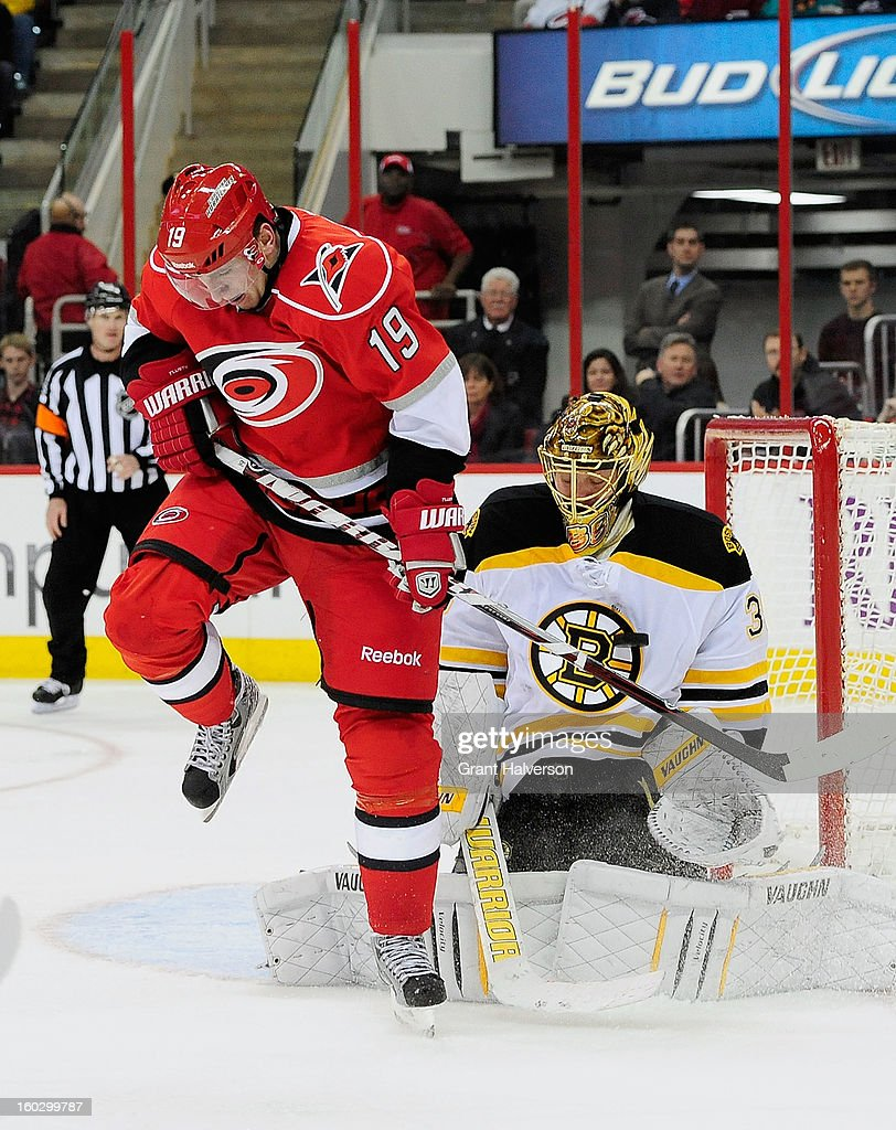 Goaltender Anton Khudobin #35 of the Boston Bruins makes a stop as Jiri Tlusty #19 of the Carolina Hurricanes sets a screen during play at PNC Arena on January 28, 2013 in Raleigh, North Carolina.