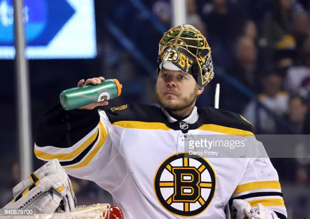 Goaltender Anton Khudobin of the Boston Bruins stays hydrated during a first period stoppage in play against the Winnipeg Jets at the Bell MTS Place...