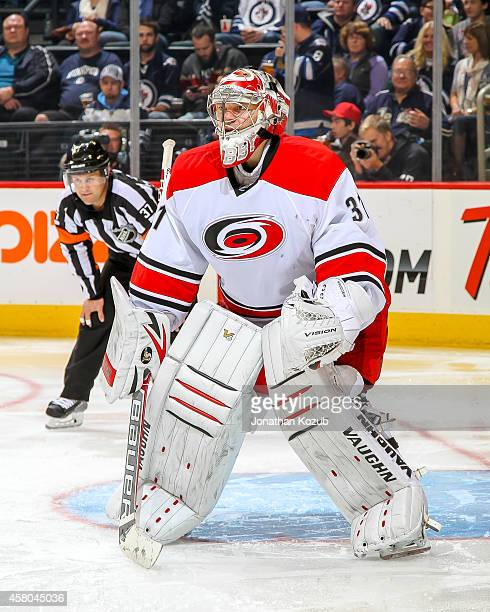 Goaltender Anton Khudobin of the Carolina Hurricanes gets set in the crease as he keeps an eye on the play during third period action against the...