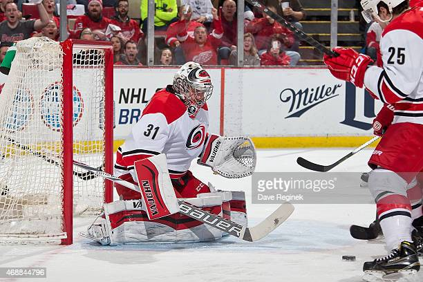 Goaltender Anton Khudobin of the Carolina Hurricanes makes a save during a NHL game against the Detroit Red Wings on April 7 2015 at Joe Louis Arena...