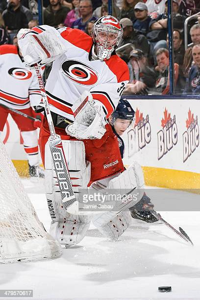 Goaltender Anton Khudobin of the Carolina Hurricanes skates with the puck against the Columbus Blue Jackets on March 18 2014 at Nationwide Arena in...