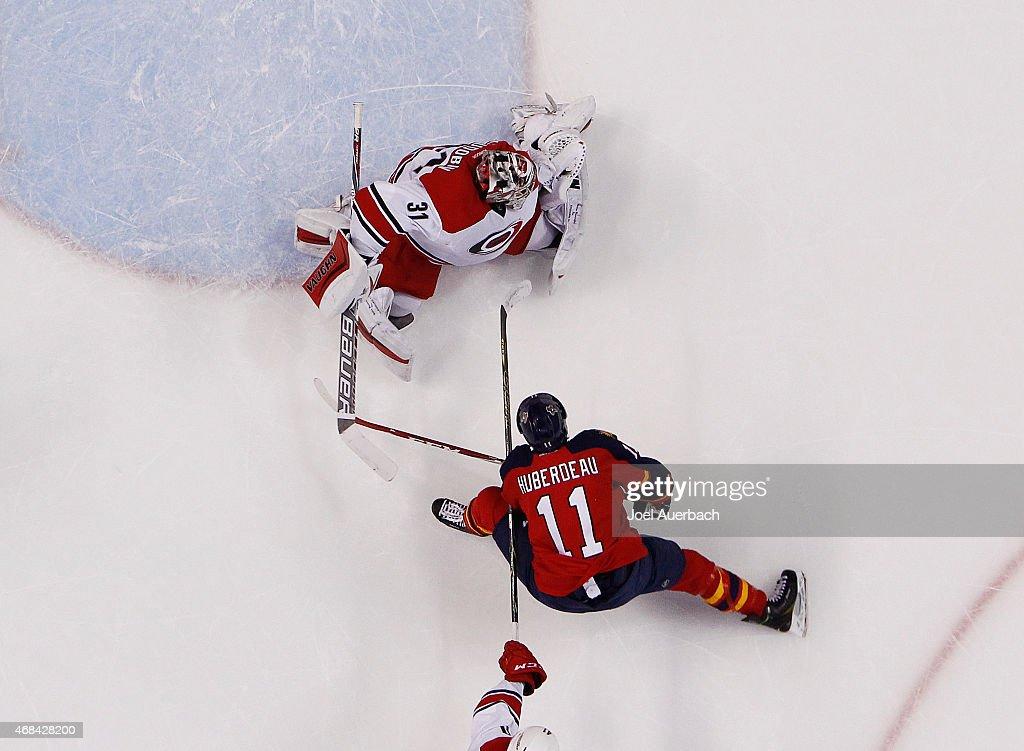 Goaltender Anton Khudobin #31 of the Carolina Hurricanes stops a first period shot by Jonathan Huberdeau #11 of the Florida Panthers at the BB&T Center on April 2, 2015 in Sunrise, Florida. The Panthers defeated the Hurricanes 6-1.