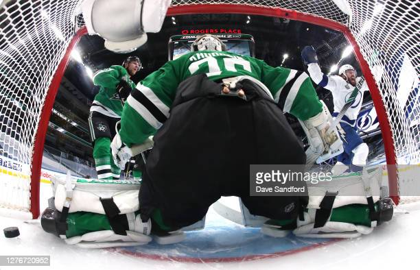 Goaltender Anton Khudobin of the Dallas Stars can't make the save on a batted puck out of the air for a goal by Brayden Point of the Tampa Bay...