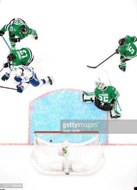 Goaltender Anton Khudobin of the Dallas Stars can't make the save on a shot for a goal by Brayden Point of the Tampa Bay Lightning in the first...