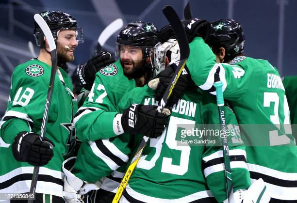 Goaltender Anton Khudobin of the Dallas Stars is congratulated by Jason Dickinson Alexander Radulov and Denis Gurianov after their 32 overtime win in...