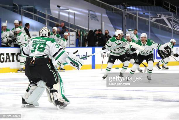 Goaltender Anton Khudobin of the Dallas Stars looks to celebrate with Mattias Janmark shortly after teammate Denis Gurianov scored the gamewinning...