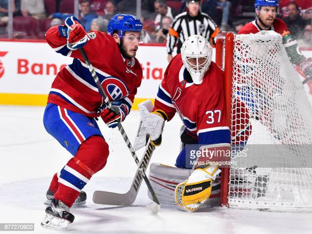 Goaltender Antti Niemi and teammate Victor Mete of the Montreal Canadiens protect the net against the Toronto Maple Leafs during the NHL game at the...
