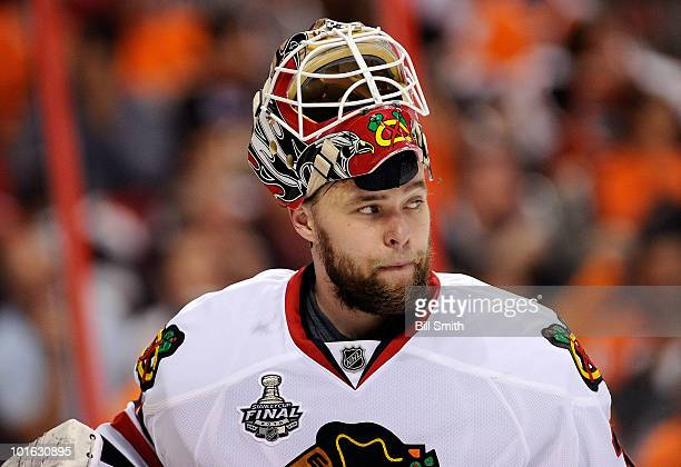 Goaltender Antti Niemi of the Chicago Blackhawks looks on between periods in Game Four of the 2010 NHL Stanley Cup Finals against the Philadelphia...