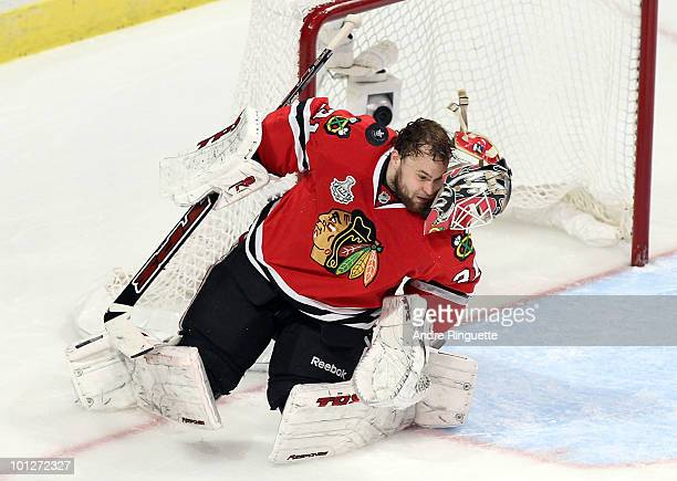 Goaltender Antti Niemi of the Chicago Blackhawks looses his helmet while making a save in the third period while taking on the Philadelphia Flyers in...