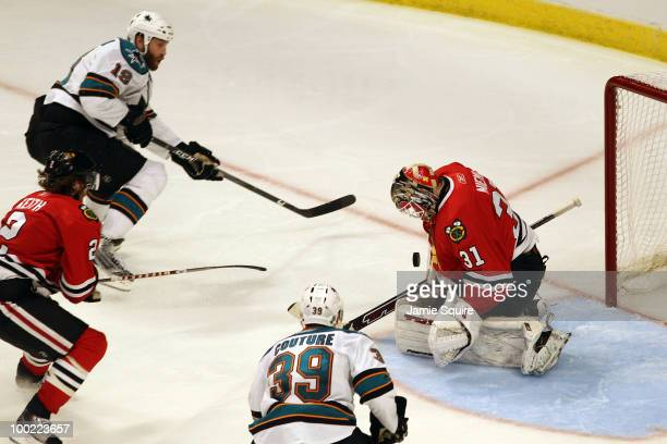 Goaltender Antti Niemi of the Chicago Blackhawks makes a save on a shot by Joe Thornton of the San Jose Sharks in the third period of Game Three of...