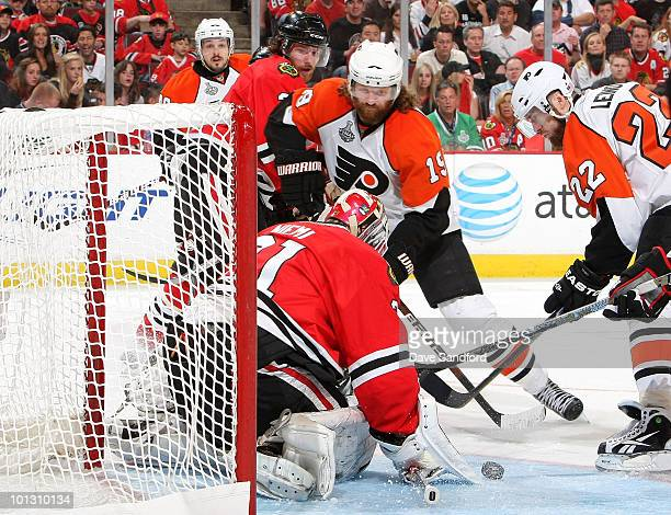Goaltender Antti Niemi of the Chicago Blackhawks makes a save on Scott Hartnell of the Philadelphia Flyers during the third period of Game Two of the...