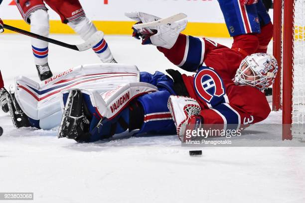 Goaltender Antti Niemi of the Montreal Canadiens falls to the ice to defend his net from the puck in the first period against the New York Rangers...