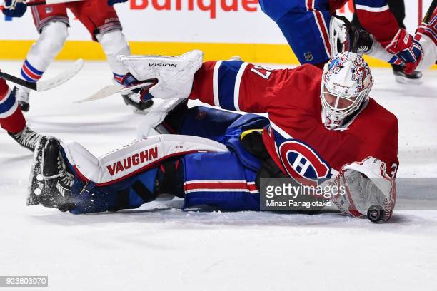 Goaltender Antti Niemi of the Montreal Canadiens falls to the ice to make a glove save in the first period against the New York Rangers during the...