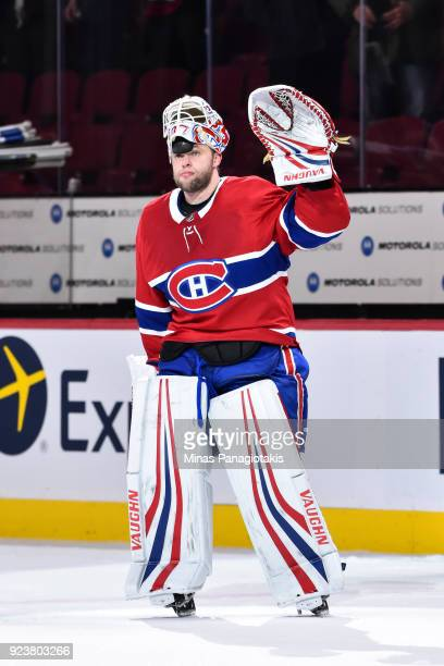 Goaltender Antti Niemi of the Montreal Canadiens raises his arm to acknowledge the fans after his victory against the New York Rangers during the NHL...