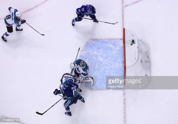 Goaltender Antti Niemi of the San Jose Sharks can't make the save on the deflection for a goal by Ryan Kesler of the Vancouver Canucks to send the...