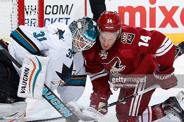Goaltender Antti Niemi of the San Jose Sharks collides with Joe Vitale of the Arizona Coyotes during the first period of the NHL game at Gila River...
