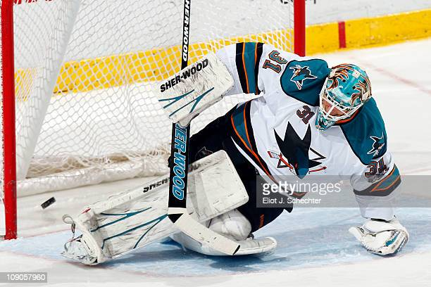 Goaltender Antti Niemi of the San Jose Sharks lets in a goal score by Chris Higgins of the Florida Panthers at the BankAtlantic Center on February 13...