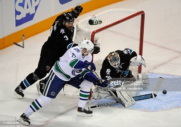 Goaltender Antti Niemi of the San Jose Sharks makes a save on a backhand wraparound scoring attempt by Daniel Sedin of the Vancouver Canucks in the...