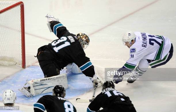 Goaltender Antti Niemi of the San Jose Sharks makes a save on a point blank attempt by Mason Raymond of the Vancouver Canucks in the first period in...