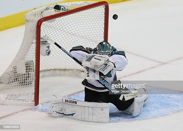Goaltender Antti Niemi of the San Jose Sharks takes a shot off his right shoulder in the first period of Game Seven of the Western Conference...