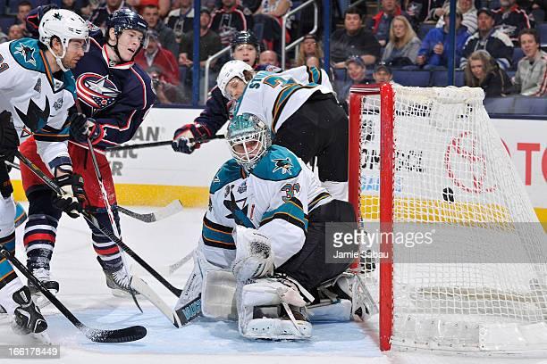Goaltender Antti Niemi of the San Jose Sharks watches as a shot taken Matt Calvert of the Columbus Blue Jackets goes into the net during the first...