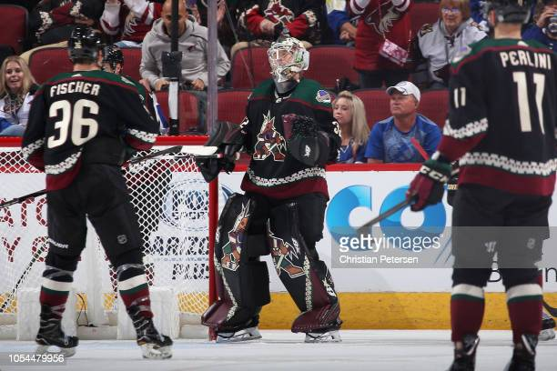 Goaltender Antti Raanta of the Arizona Coyotes celebrates with Christian Fischer after defeating the Tampa Bay Lightning in the NHL game at Gila...