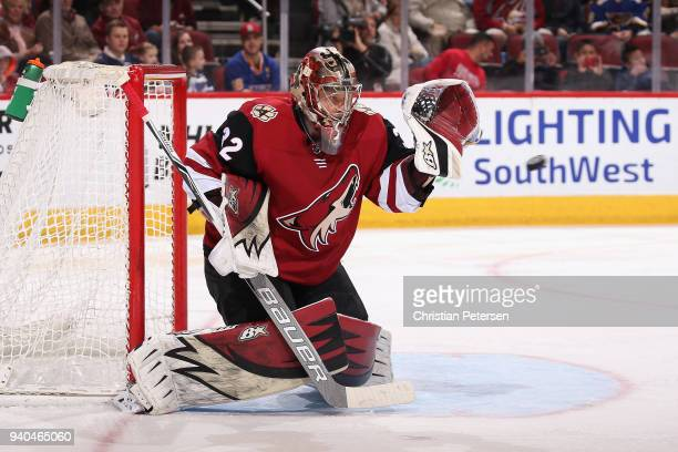 Goaltender Antti Raanta of the Arizona Coyotes makes a glvoe save on the shot from the St Louis Blues during the second period of the NHL game at...