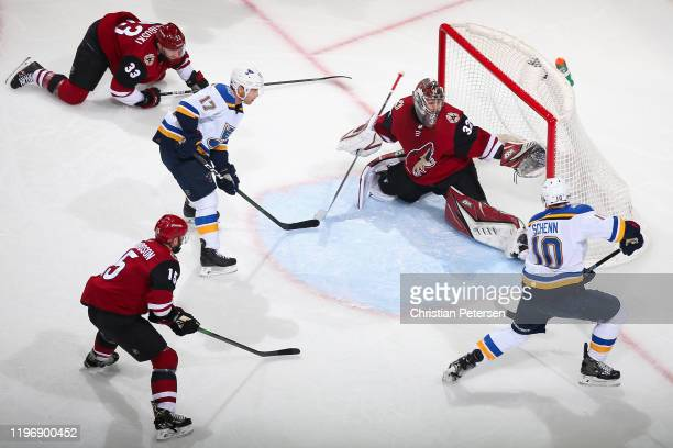 Goaltender Antti Raanta of the Arizona Coyotes makes a pad save on the shot from Brayden Schenn of the St. Louis Blues during the second period of...