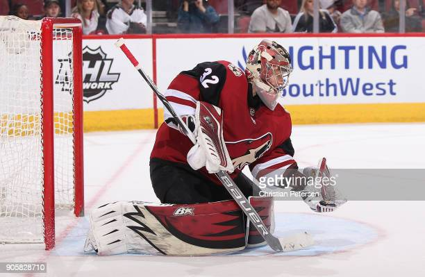 Goaltender Antti Raanta of the Arizona Coyotes mkaes a glove save on a shot from the San Jose Sharks in overtime of the NHL game at Gila River Arena...