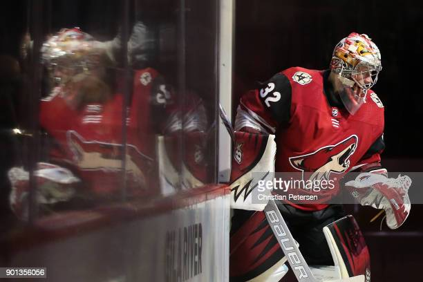 Goaltender Antti Raanta of the Arizona Coyotes skates out onto the ice before the NHL game against the Nashville Predators at Gila River Arena on...