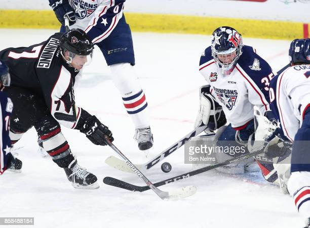 Goaltender Beck Warm of the TriCity Americans makes a save on Ty Ronning of the Vancouver Giants during the first period of their WHL game at the...