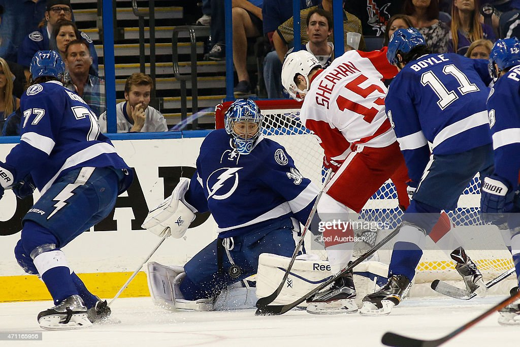 Goaltender Ben Bishop #30 of the Tampa Bay Lightning against stops a shot by Riley Sheahan #15 of the Detroit Red Wings during the second period in Game Five of the Eastern Conference Quarterfinals during the 2015 NHL Stanley Cup Playoffs at the Amalie Arena on April 25, 2015 in Tampa, Florida.